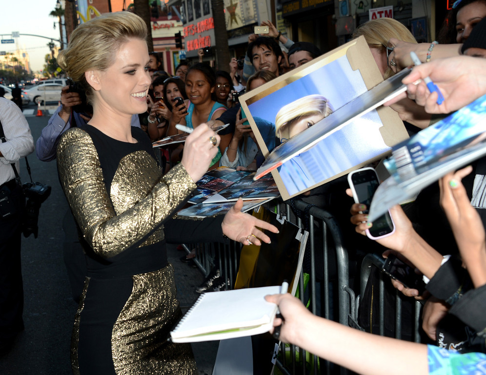 """. Actress Alice Eve signs autographs as she arrives at the Premiere of Paramount Pictures\' \""""Star Trek Into Darkness\"""" at Dolby Theatre on May 14, 2013 in Hollywood, California.  (Photo by Kevin Winter/Getty Images for Paramount Pictures)"""