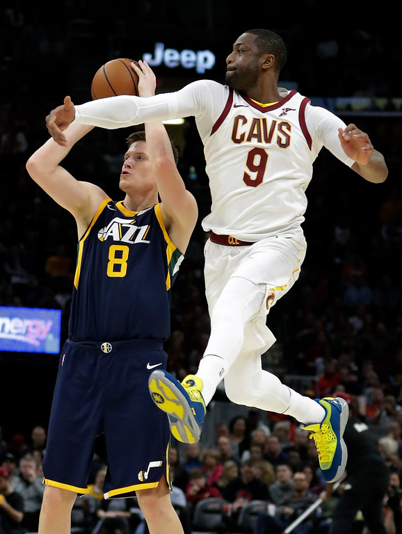 . Utah Jazz\'s Jonas Jerebko (8), from Sweden, shoots against Cleveland Cavaliers\' Dwyane Wade (9) in the first half of an NBA basketball game, Saturday, Dec. 16, 2017, in Cleveland. (AP Photo/Tony Dejak)
