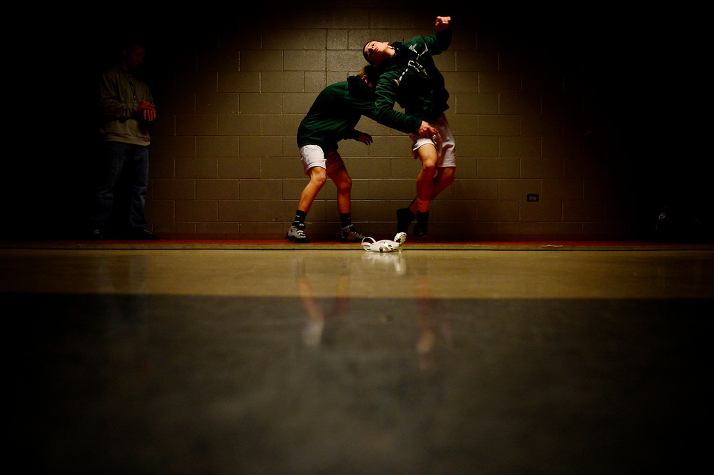 . DENVER, CO - FEBRUARY 21: Niwot 132-pounder Joey Lambert escapes with a standup from teammate  106-pounder Clayton Robinson during the Colorado State High School Wrestling Championships. The state finals will run through Saturday evening at the Pepsi Center. (Photo by AAron Ontiveroz/The Denver Post)