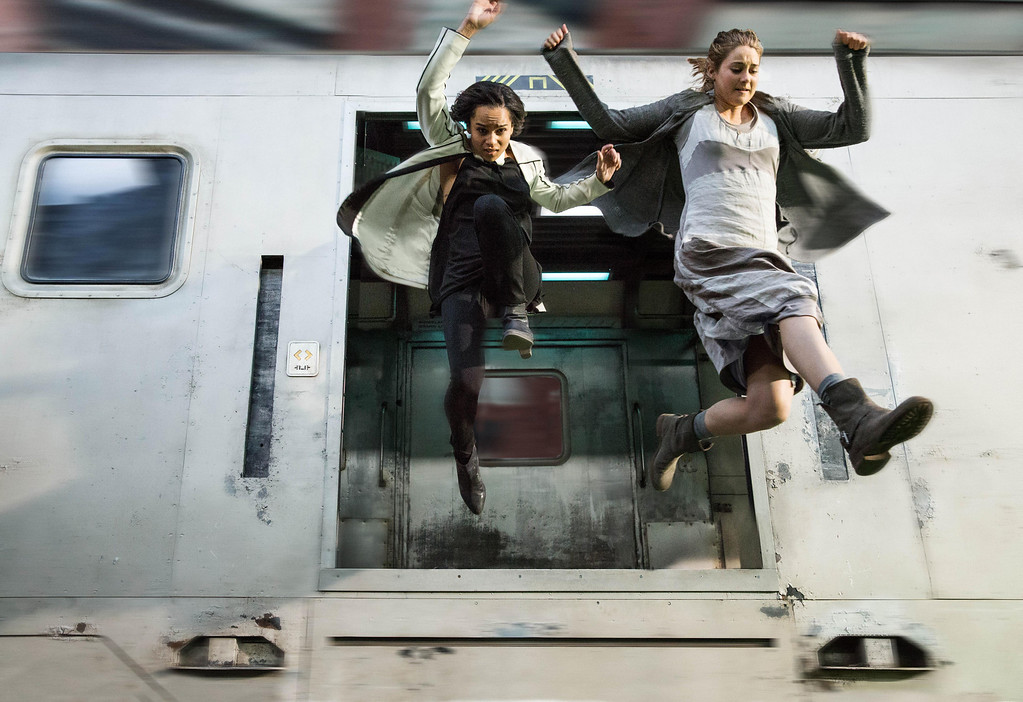 """. This image released by Summit Entertainment shows Zoe Kravitz, left, and Shailene Woodley in a scene from \""""Divergent.\"""" (AP Photo/Summit Entertainment, Jaap Buitendijk)"""