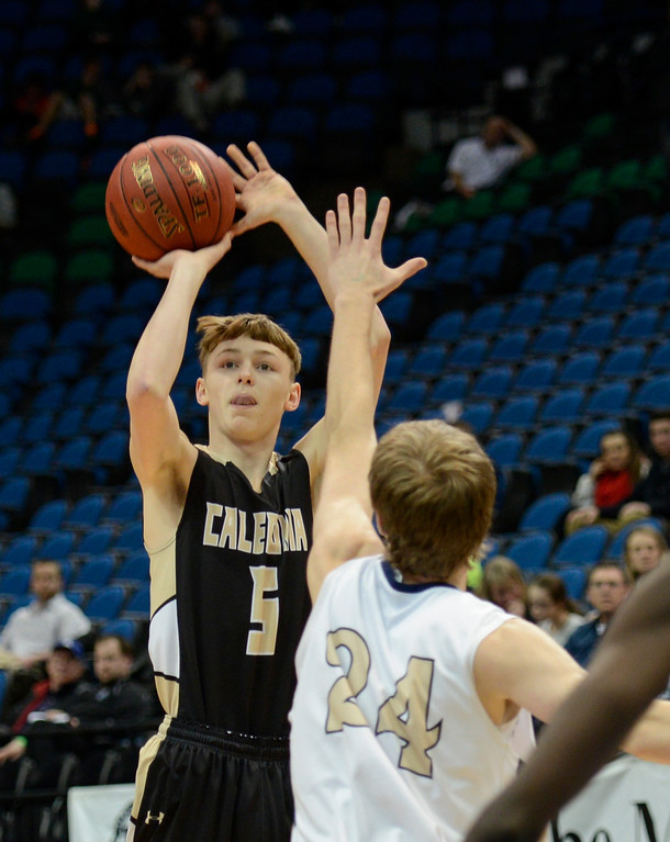 . Caledonia\'s Josh Nord shoots during the first half as SPA\'s Harrisen Egly attempts to block the shot. (Special to the Pioneer Press: Matt Mead)