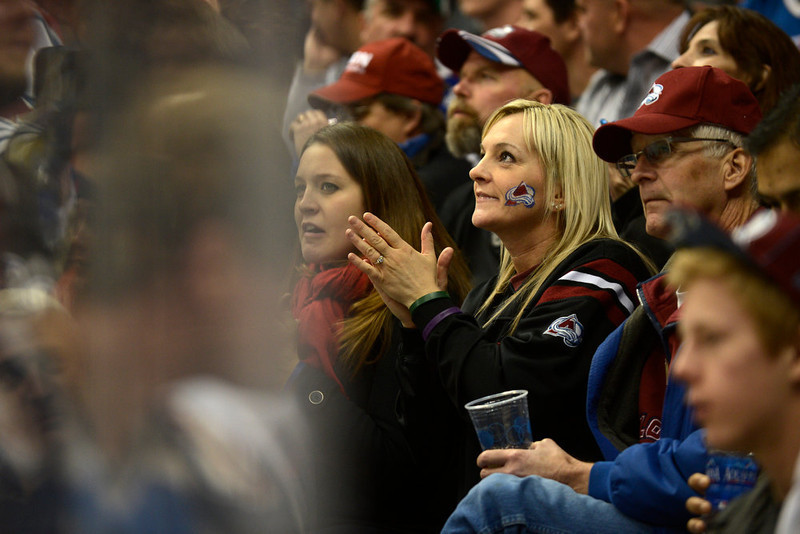 . DENVER, CO. - JANUARY 22: A Colorado Avalanche fan watches the action against the Los Angeles Kings during the third period. The Colorado Avalanche Los Angeles Kings at Pepsi Center January 22, 2013.  (Photo By John Leyba / The Denver Post)