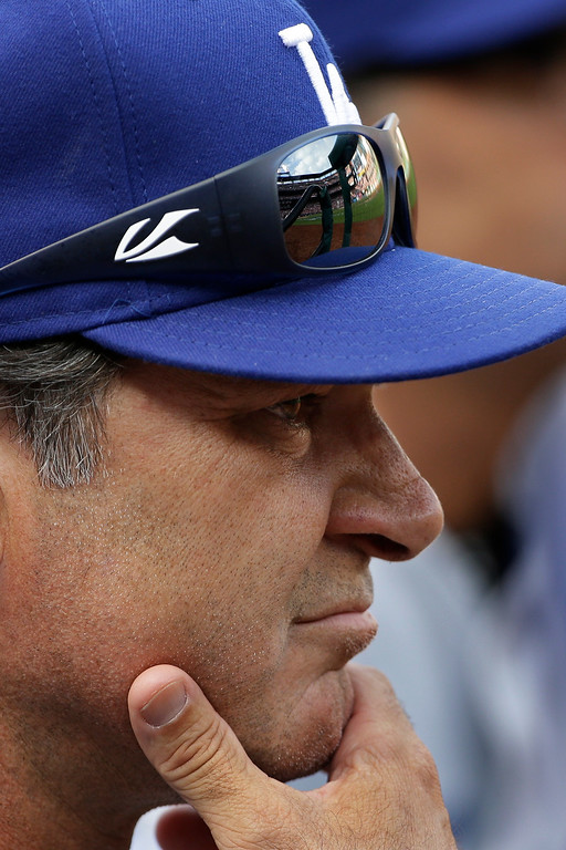 . Los Angeles Dodgers manager Don Mattinglyn watches from the dugout during the seventh inning of Game 2 of the National League baseball championship series against the St. Louis Cardinals Saturday, Oct. 12, 2013, in St. Louis. (AP Photo/David J. Phillip)