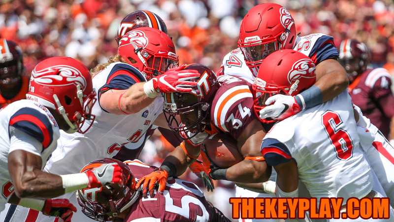RB Travon McMillian (34) pushes through a pile of Liberty defenders for a short gain. (Mark Umansky/TheKeyPlay.com)