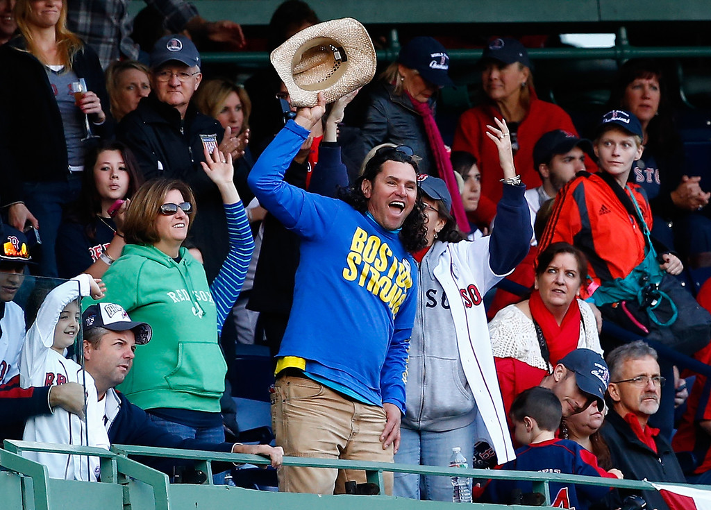 . BOSTON, MA - NOVEMBER 02: Carlos Arredondo cheers during the World Series victory parade at Fenway Park on November 2, 2013 in Boston, Massachusetts.  (Photo by Jared Wickerham/Getty Images)