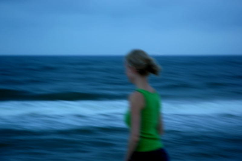 Impressionistic picture of Kate walking the beach at dusk.