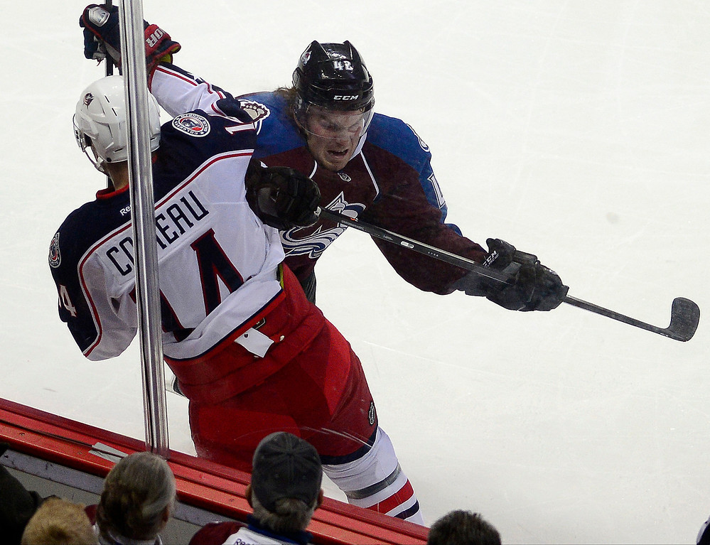 . Brad Malone (42) of the Colorado Avalanche checks Blake Comeau (14) of the Columbus Blue Jackets during the second period. The Colorado Avalanche hosted the Columbus Blue Jackets at the Pepsi Center on Tuesday, December 31, 2013. (Photo by AAron Ontiveroz/The Denver Post)