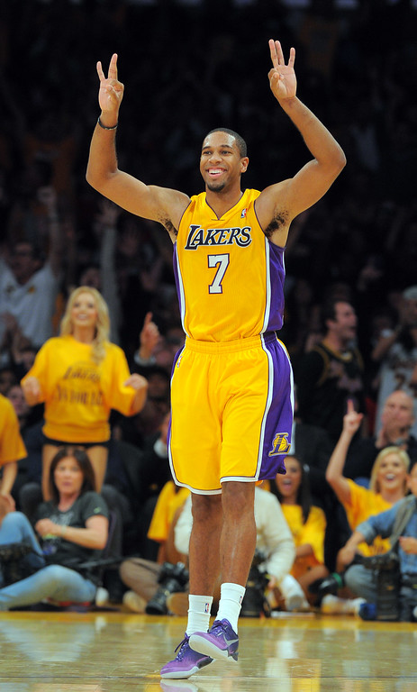 . Lakers Xavier Henry celebrates a 3-pointer by Wesley Johnson in the 4th qtr in the NBA season opener between the Lakers and Clippers at Staples Center in Los Angeles, CA on Tuesday, October 29, 2013.  Lakers won 116-103. (Photo by Scott Varley, Daily Breeze)