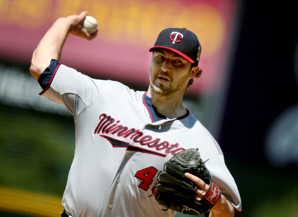 . Minnesota Twins starting pitcher Phil Hughes works against the Colorado Rockies in the first inning of an interleague baseball game in Denver on Sunday, July 13, 2014. (AP Photo/David Zalubowski)