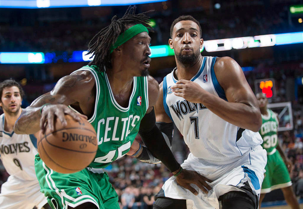 . Boston Celtics\' Gerald Wallace, left, drives to the net as Minnesota Timberwolves\' Derrick Williams defends during the second quarter.(AP Photo/The Canadian Press, Graham Hughes)