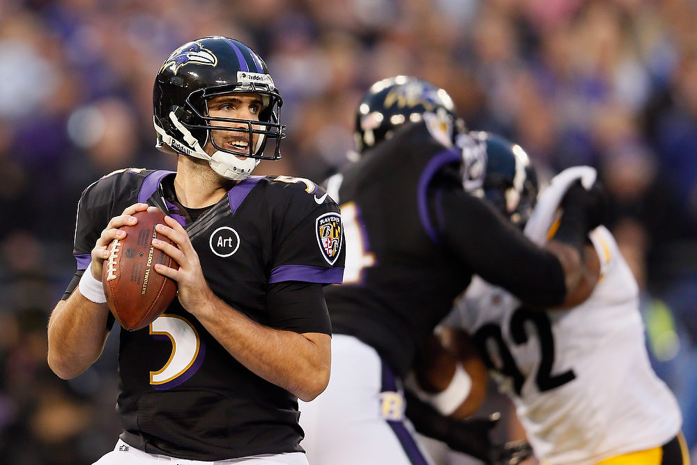 Description of . Quarterback Joe Flacco #5 of the Baltimore Ravens drops back to pass against the Pittsburgh Steelers during the first half at M&T Bank Stadium on December 2, 2012 in Baltimore, Maryland.  (Photo by Rob Carr/Getty Images)