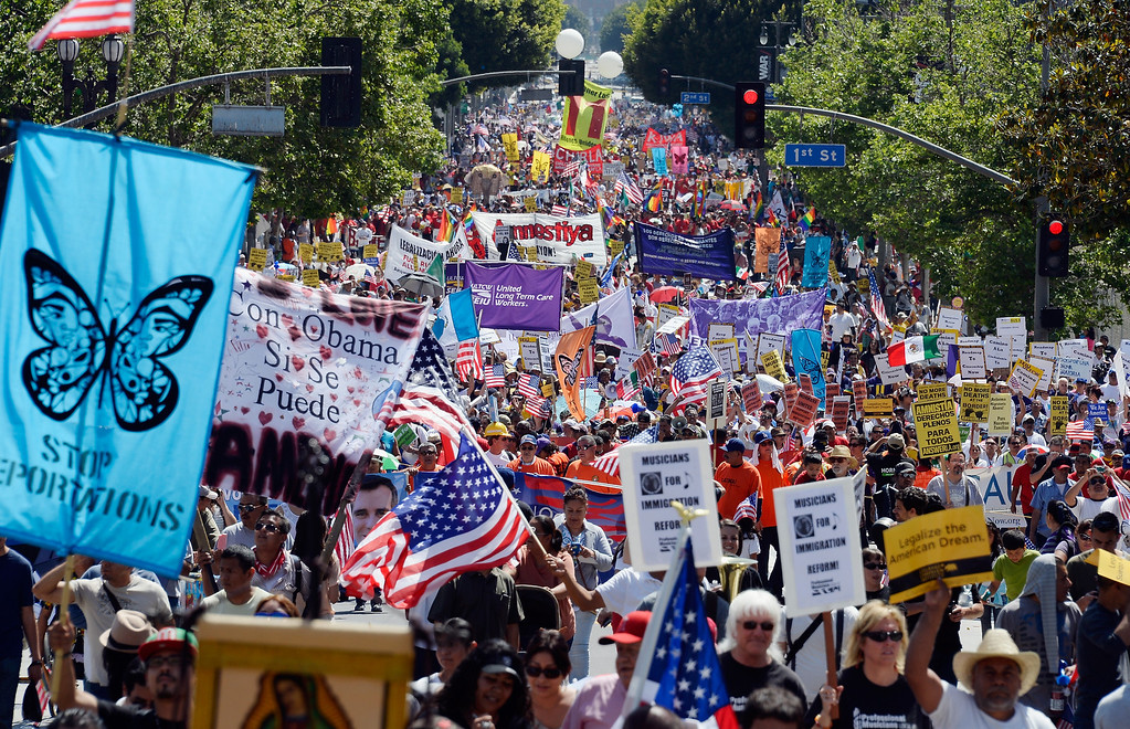 . LOS ANGELES, CA - MAY 01:  Thousands of people participate in the May Day march and rally on May 1, 2013 in Los Angeles, California. Labor organizations and immigration groups used the annual celebration to push for an immigration system overhaul.  (Photo by Kevork Djansezian/Getty Images)