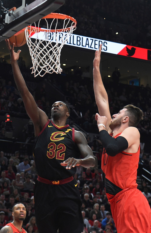 . Cleveland Cavaliers forward Jeff Green, left, drives to the basket on Portland Trail Blazers center Jusuf Nurkic, right, during the first half of an NBA basketball game in Portland, Ore., Thursday, March 15, 2018. (AP Photo/Steve Dykes)