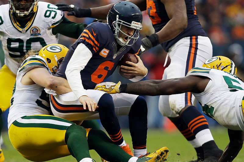 . Chicago Bears quarterback Jay Cutler (6) is sacked by Green Bay Packers linebacker Clay Matthews, left, in the second half of an NFL football game in Chicago, Sunday, Dec. 16, 2012. At right is Packers  linebacker Dezman Moses. The Packers won 21-13 to clinch the NFC North division title. (AP Photo/Nam Y. Huh)