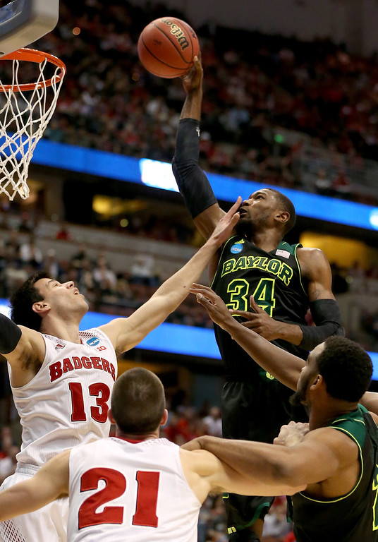 . Cory Jefferson #34 of the Baylor Bears goes up for a shot against Duje Dukan #13 of the Wisconsin Badgers in the second half during the regional semifinal of the 2014 NCAA Men\'s Basketball Tournament at the Honda Center on March 27, 2014 in Anaheim, California.  (Photo by Jeff Gross/Getty Images)