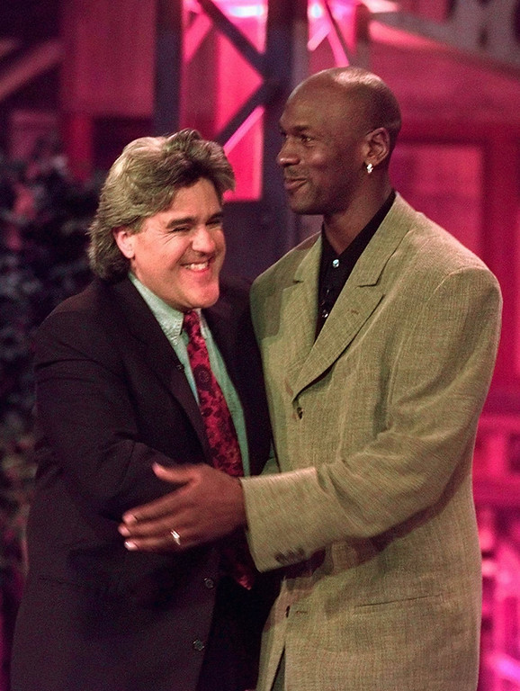 """. Chicago Bulls\' Michael Jordan hugs Jay Leno Friday, May 3, 1996, in Rosemont, Ill., after being introduced during a taping of \""""The Tonight Show.\""""   (AP Photo/Michael S. Green)"""
