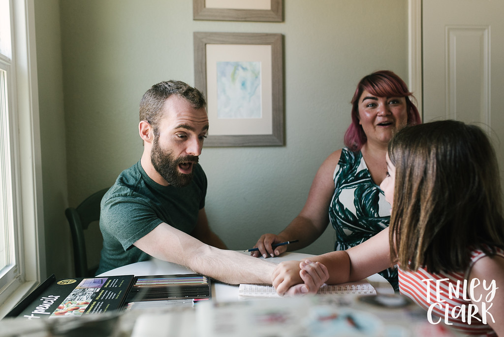Arm wrestling. Lifestyle in home family photography session in Fremont, CA by Tenley Clark Photography.