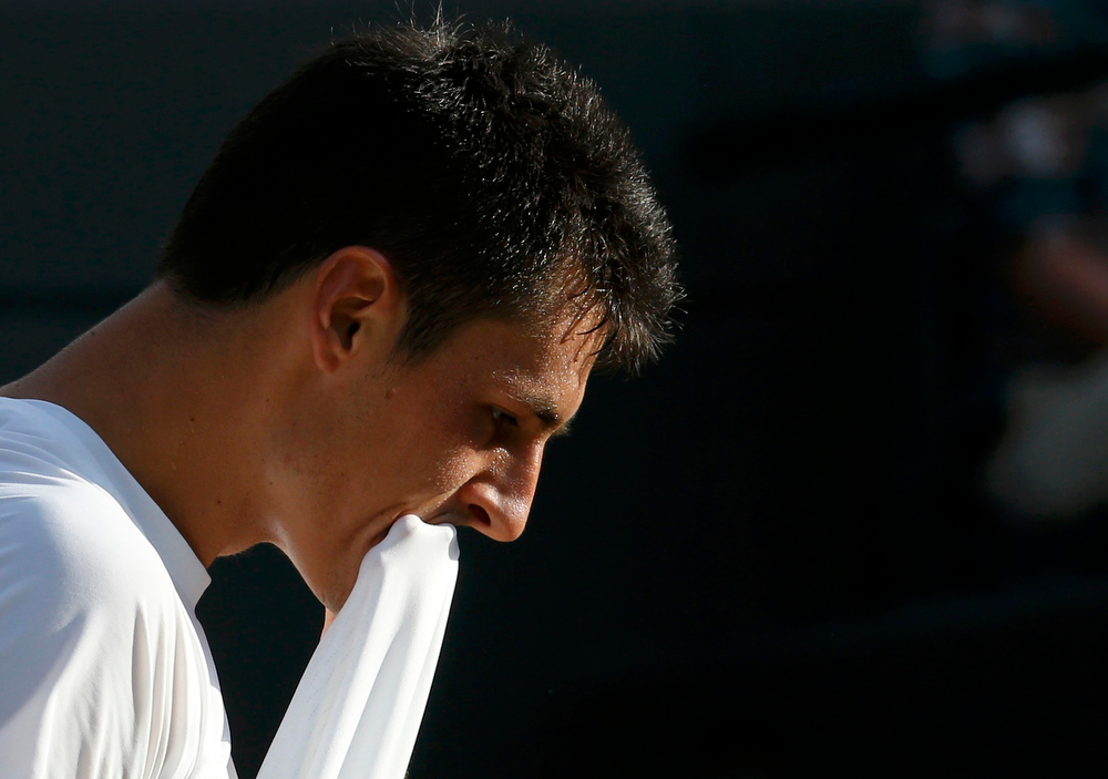 . Bernard Tomic of Australia reacts during his men\'s singles tennis match against Tomas Berdych of the Czech Republic at the Wimbledon Tennis Championships, in London July 1, 2013.      REUTERS/Suzanne Plunkett