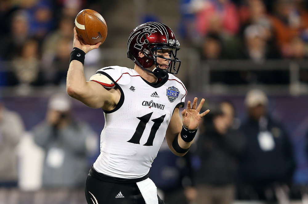 . Brendon Kay #11 of the Cincinnati Bearcats drops back to pass against the Duke Blue Devils during their game at Bank of America Stadium on December 27, 2012 in Charlotte, North Carolina.  (Photo by Streeter Lecka/Getty Images)