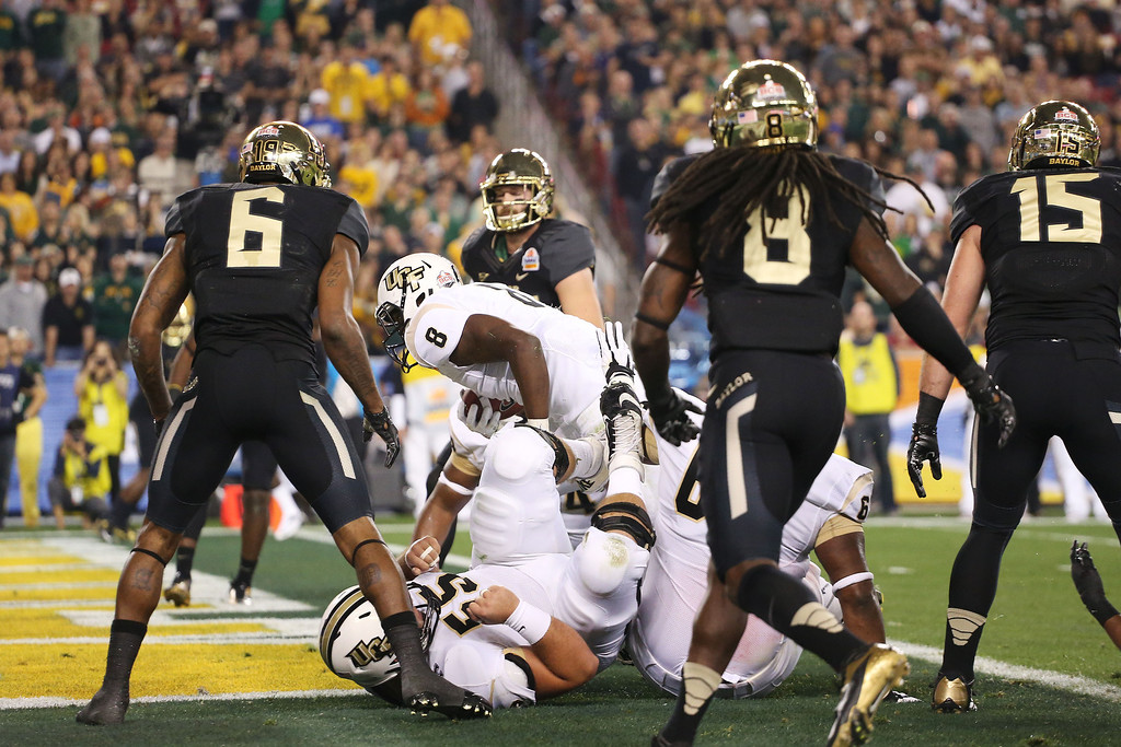 . GLENDALE, AZ - JANUARY 01:  Storm Johnson #8 of the UCF Knights runs for a first quarter touchdown against the Baylor Bears during the Tostitos Fiesta Bowl at University of Phoenix Stadium on January 1, 2014 in Glendale, Arizona.  (Photo by Christian Petersen/Getty Images)