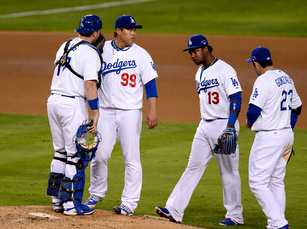 . Dodger pitcher Hyun-Jin Ryu talks with teammates during game 3 against the St. Louis Cardinals in the NLCS at Dodger Stadium Monday, October 14, 2013. The Dodgers beat the Cardinals 3-0. (Photo by Sarah Reingewirtz/Los Angeles Daily News)