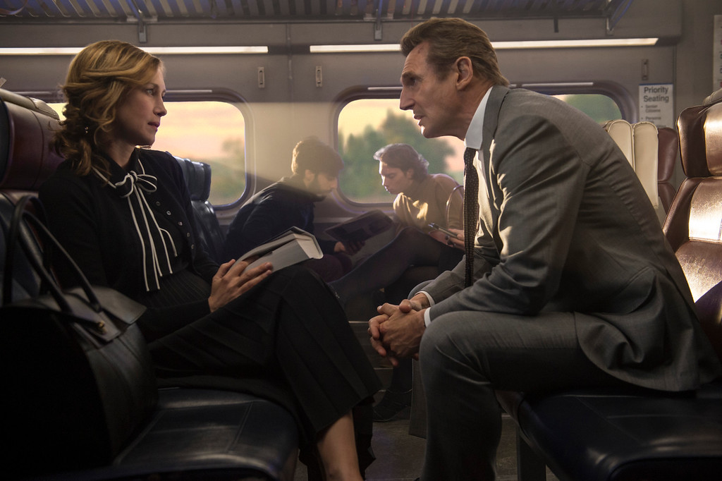 ". Vera Farmiga, left, and Liam Neeson share in a scene from ""The Commuter,\"" in theaters Jan. 12. (Jay Maidment/Lionsgate via AP)"