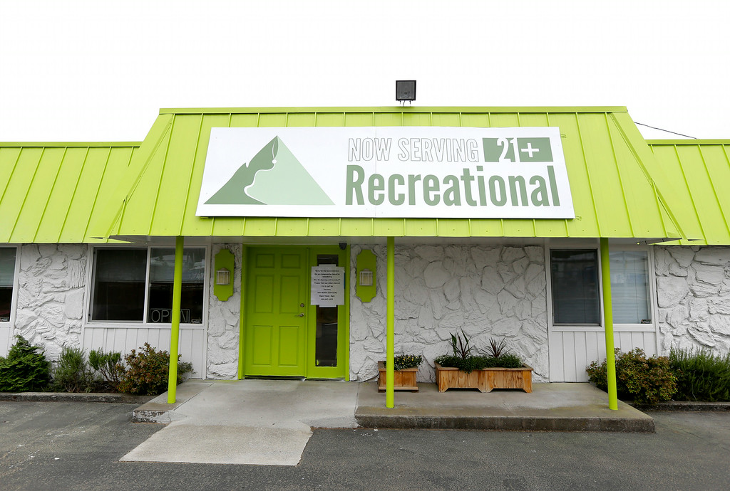 . The sign promoting recreational marijuana sales is displayed at the Rainier on Pine recreational marijuana store in Tacoma, Wash., Monday, July 7, 2014. The store won\'t be opening on Tuesday when legal sales begin due problems getting enough pot from growers and processors. The store\'s owner says he is confident supplies will stabilize soon and says they will be open for business later in July. (AP Photo/Ted S. Warren)