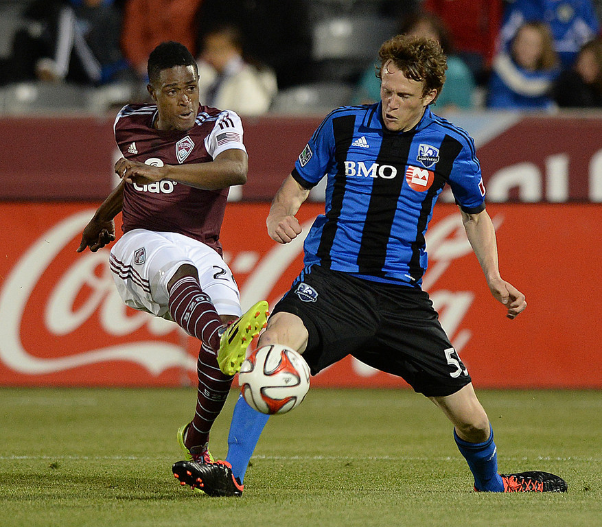 . Colorado forward Deshorn Brown (26) took a shot past Montreal midfielder Wandrille Lefevre (55) in the second half. The Colorado Rapids defeated the Montreal Impact 4-1 Saturday night, May 24, 2014. (Photo by Karl Gehring/The Denver Post)