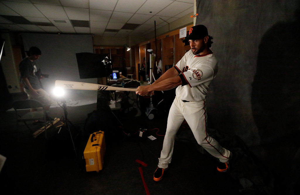 . San Francisco Giants\' Angel Pagan poses for a picture during baseball spring training photo day Wednesday, Feb. 20, 2013 in Scottsdale, Ariz. (AP Photo/Morry Gash)