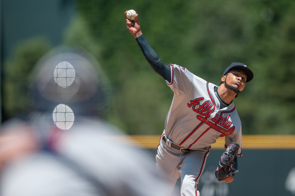 . Ervin Santana #30 of the Atlanta Braves delivers a pitch against the Colorado Rockies in the first inning of a game at Coors Field on June 12, 2014 in Denver, Colorado.  The game was tied with no score after one inning. (Photo by Dustin Bradford/Getty Images)