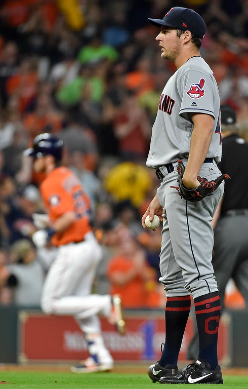 . Cleveland Indians starting pitcher Trevor Bauer, right, looks on as Houston Astros Josh Reddick rounds the bases after hitting a solo home run during the third inning of a baseball game, Friday, May 19, 2017, in Houston. (AP Photo/Eric Christian Smith)