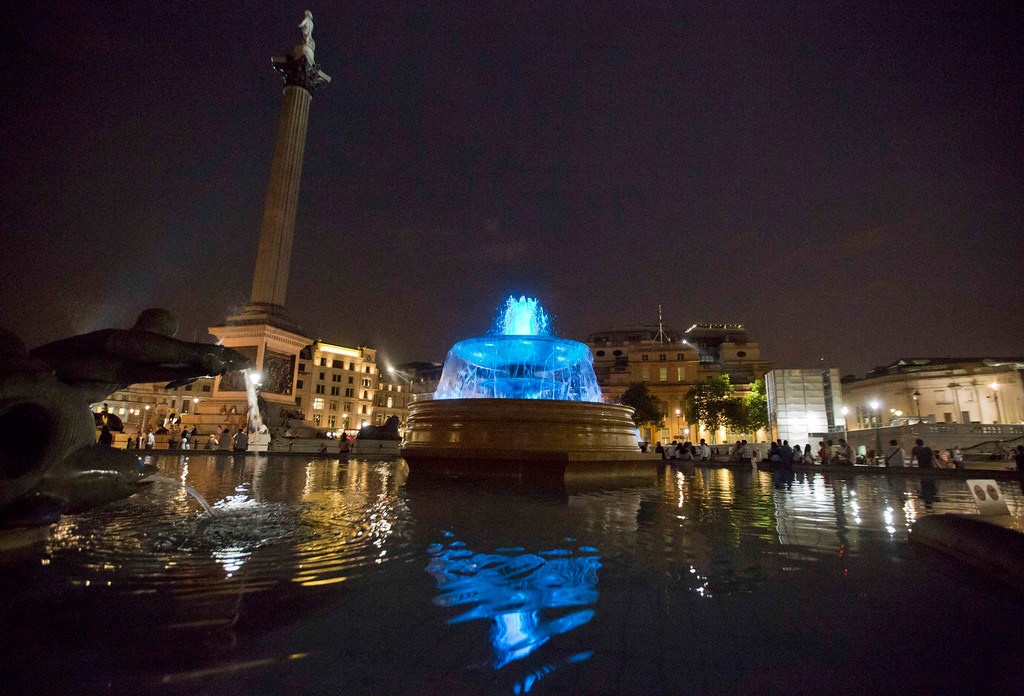 . The fountains at Trafalgar Square are seen lit blue to signify the birth of a baby boy to Britain\'s Prince William and Catherine, Duchess of Cambridge in London July 22, 2013.  Prince William\'s wife Kate gave birth, in the Lindo Wing of St Mary\'s Hospital,  on Monday to a baby boy who becomes third in line to the British throne. The royal baby, the couple\'s first child, was born at 4:24 p.m., weighing 8 lbs and 6 oz. REUTERS/Neil Hall