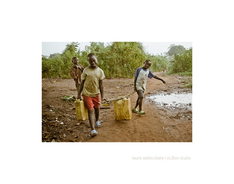 SHARING THE BURDEN After filling their containers of water — called a jerry can — children must walk home with their heavy load, which will be used for drinking, bathing, cleaning and cooking.