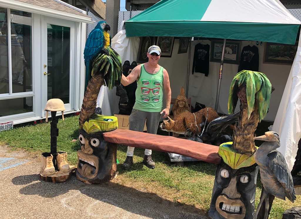 . Tawana Roberts � The News-Herald <br> Chainsaw Artist Matthew Hannah showcases a few notable sculptures at the 2018 Lake County Fair on July 26.