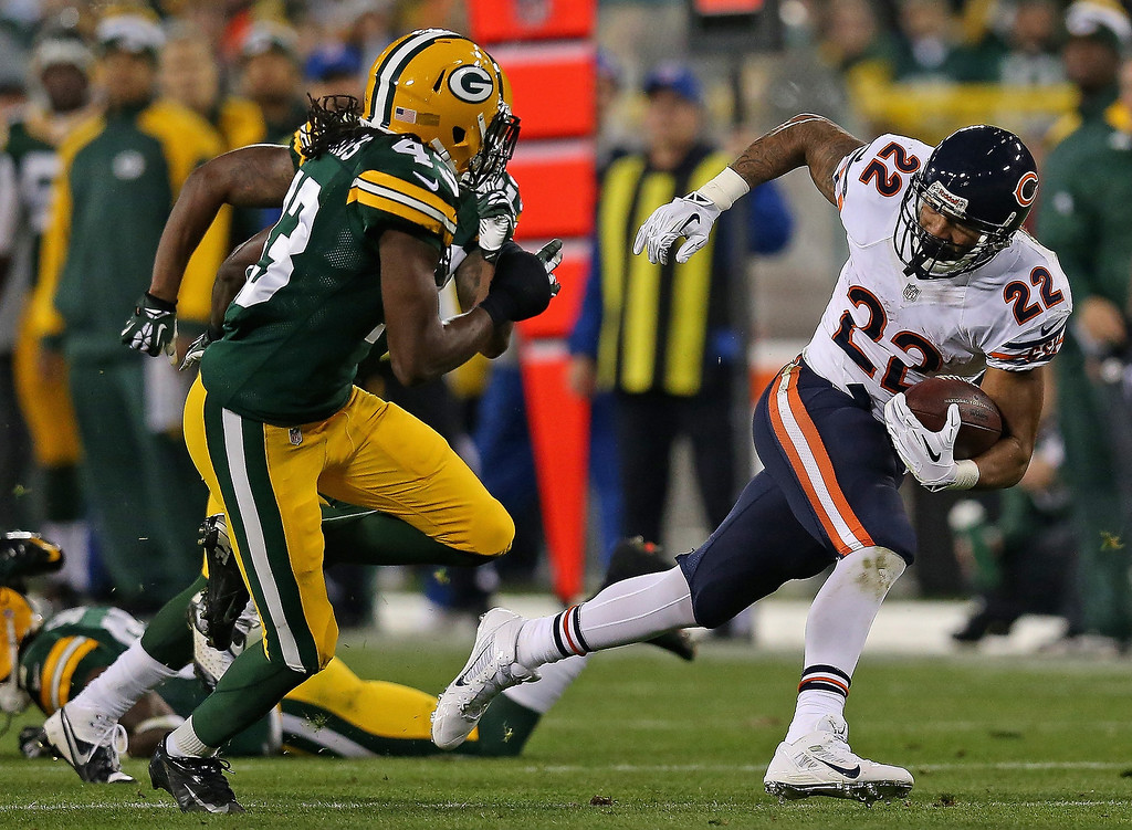 . Matt Forte #22 of the Chicago Bears breaks a long run after catching a pass chased by M.D. Jennings #43 of the Green Bay Packers at Lambeau Field on November 4, 2013 in Green Bay, Wisconsin.  (Photo by Jonathan Daniel/Getty Images)