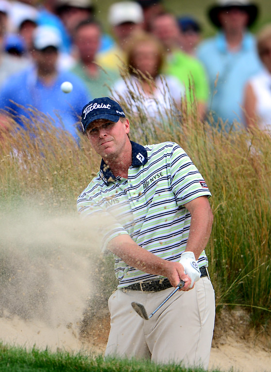. ARDMORE, PA - JUNE 16:  Steve Stricker of the United States hits his fourth shot from a bunker on the fourth hole during the final round of the 113th U.S. Open at Merion Golf Club on June 16, 2013 in Ardmore, Pennsylvania.  (Photo by David Cannon/Getty Images)