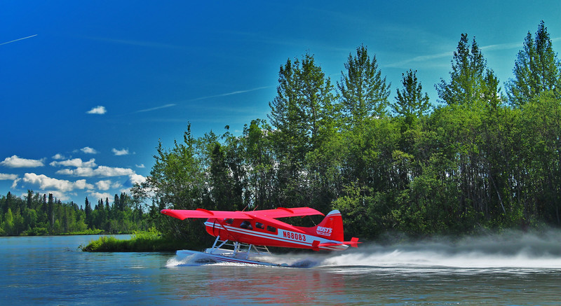 A Float Plane taking off of the Yentna River in Alaska