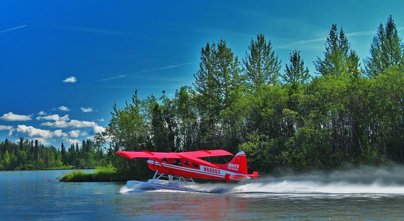 A Float Plane taking off of the Yentna River in Alaska
