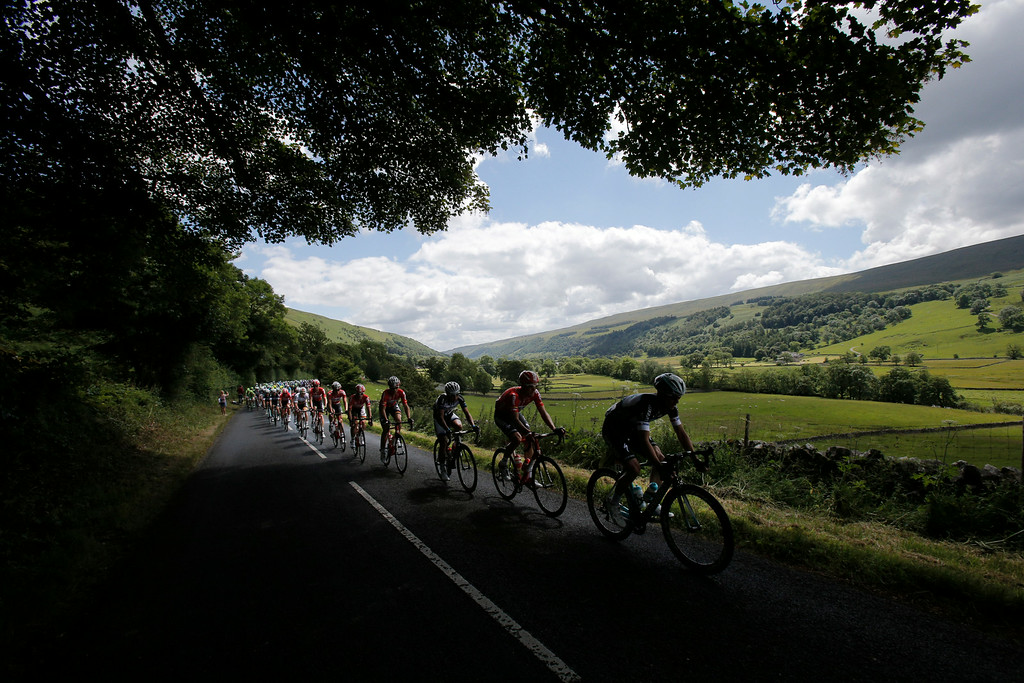 . The pack rides through the rolling hills of Yorkshire during the first stage of the Tour de France cycling race over 190.5 kilometers (118.4 miles) with start in Leeds and finish in Harrogate, England, Saturday, July 5, 2014. (AP Photo/Christophe Ena)