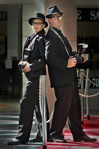 The Reporters. Actually, they're spruiking or touting outside a shop in Surfers Paradise, Australia.