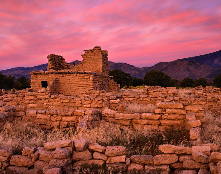 Dawn over the Puujee ruins of the Santa Clara Pueblo with the Jemez Mountains in the background.  The background left valley on the horizon is the Santa Clara River drainage headwaters, flowing from the tribe's reacquired P' opii Khanu land further upstream. Puujee Pueblo ruins date from about 1300 AD and was thought to be inhabited by as many as 3000 people.