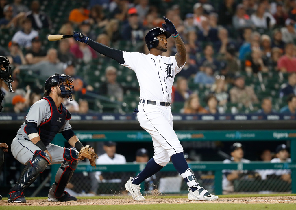 . Detroit Tigers\' Niko Goodrum hits a three-run home run in the eighth inning of a baseball game against the Cleveland Indians in Detroit, Monday, May 14, 2018. (AP Photo/Paul Sancya)