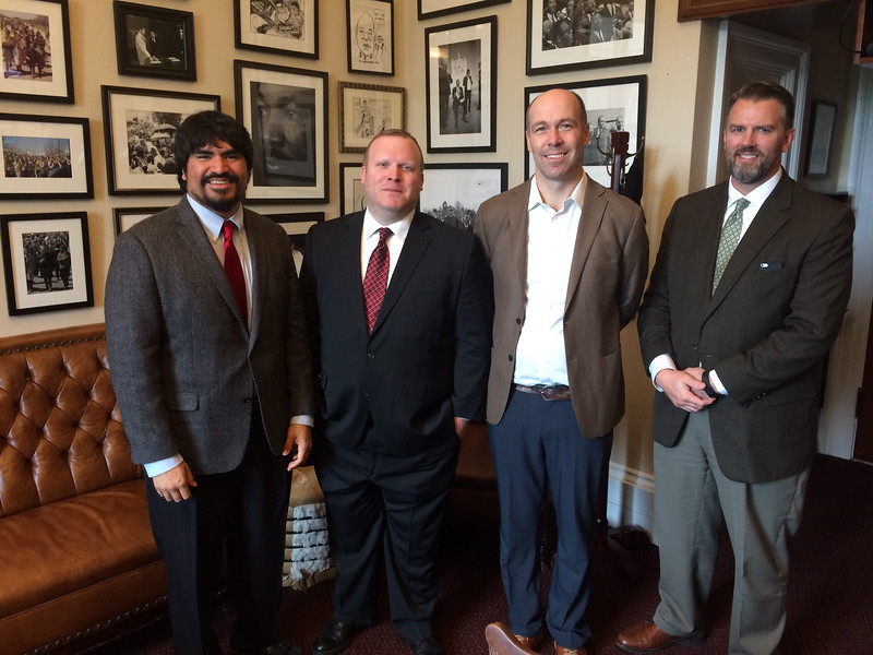 left to right: Oliver Rosales, Andrew Bond, Josh Ottum and National Endowment of the Humanities Congressional Affairs Director Timothy Robinson stand outside the office of Congressman John Lewis (D-GA).
