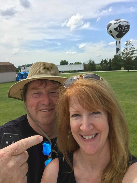 Warren Shaw, left, and his girlfriend Mary Jane McArdle, right, at Fair Oaks Farm in Indiana during their recent cross-country road trip.