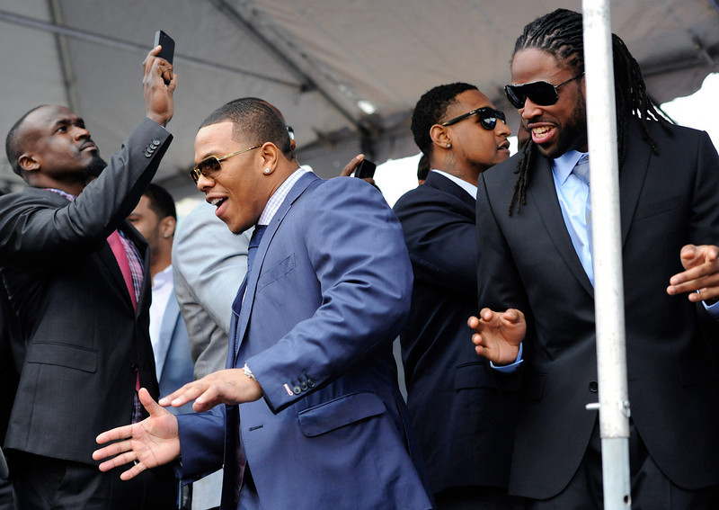 . Baltimore Ravens running back Ray Rice, center, dances for teammates wide receiver Deonte Thompson, left, and wide receiver Torrey Smith, right, during a send-off rally on Monday, Jan. 28, 2013 in Baltimore. The NFL football team is leaving for New Orleans to face the San Francisco 49ers in the Super Bowl. (AP Photo/Steve Ruark)