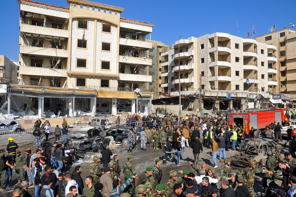 . Lebanese army soldiers and members of civilian defense inspect the damage at the site of an explosion near the Kuwaiti Embassy and Iran\'s Chancellery center, in Beir Hassan area at southern suburbs of Beirut, Lebanon, 19 February 2014.  EPA/WAEL HAMZEH
