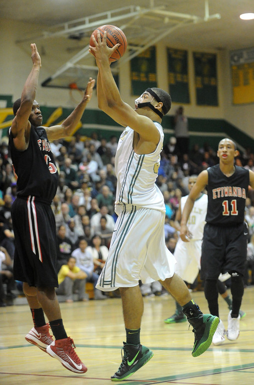 . 02-26-2012--(LANG Staff Photo by Sean Hiller)-Etiwanda beat Long Beach Poly 59-55 in Tuesday\'s CIF Southern Section Division 1AA semifinal boys basketball game at Long Beach Poly High School. Kameron Murrell shoots for Poly.