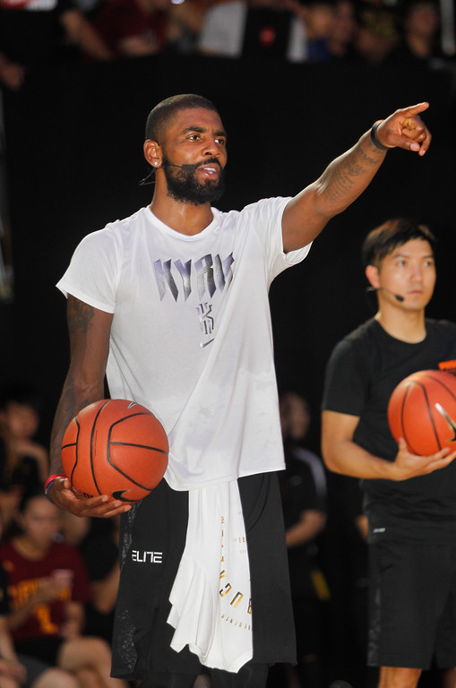 . NBA Cleveland Cavaliers guard Kyrie Irving gives instructions while he holds a short basketball clinic with young Taiwanese players in Taipei, Taiwan, Saturday, July 22, 2017.(AP Photo/Chiang Ying-ying)