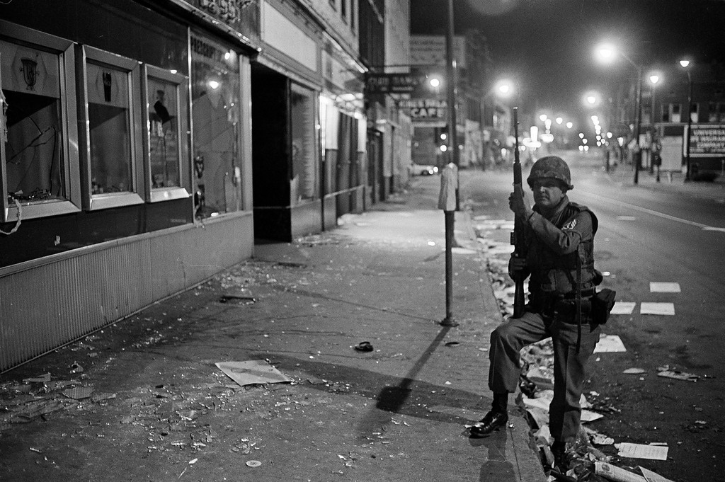. A lone Tennessee National Guardsman maintains an all-night vigil at the glass-littered corner of Beale and Hernando Streets in downtown Memphis, Tenn., after major looting and rioting earlier in the day, March 28. 1968. National Guard troops donned flak jackets after reports of an isolated sniping incident circulated among the 4,000 troops present in Memphis. (AP Photo/Jack Thornell)