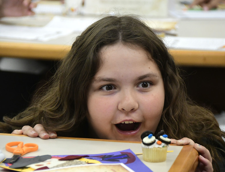 7/31/2018 Mike Orazzi   Staff Riley Livingston,10, stares at a cupcake she made while celebrating  Harry Potter's birthday during Harry Potter Day at the  Manross Library in Forestville Tuesday afternoon.